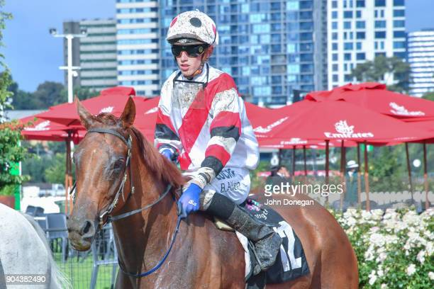Ben Allen returns to the mounting yard aboard Sharing after winning the Tauto Handicap at Flemington Racecourse on January 13 2018 in Flemington...