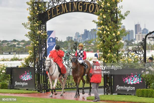 Ben Allen returns to the mounting yard on Ken's Dream after winning the Better Beyond Plate at Flemington Racecourse on January 13 2018 in Flemington...