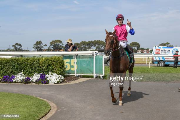 Ben Allen returns to the mounting yard on Seento after winning the Connect Tel BM64 Handicap at Geelong Racecourse on January 11 2018 in Geelong...