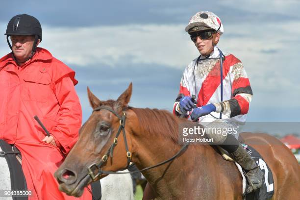 Ben Allen returns to the mounting yard on Sharing after winning the Tauto Handicap at Flemington Racecourse on January 13 2018 in Flemington Australia