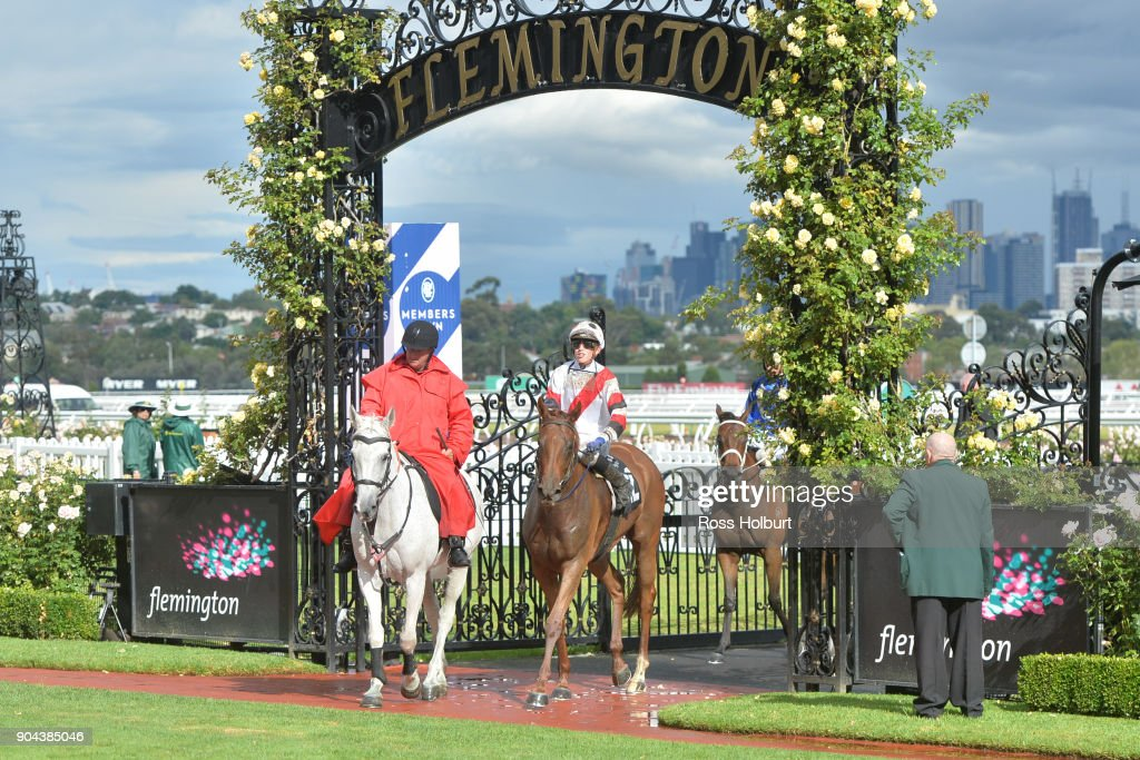 Ben Allen returns to the mounting yard on Sharing after winning the Tauto Handicap at Flemington Racecourse on January 13, 2018 in Flemington, Australia.
