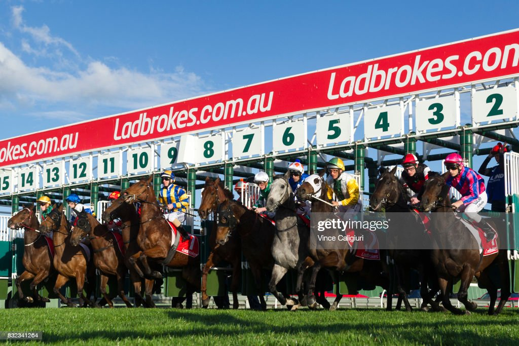 Ben Allen riding Bonus D' Oro (L) jumps out of barriers before winning Race 9 during Melbourne Racing at Sandown Lakeside on August 16, 2017 in Melbourne, Australia.