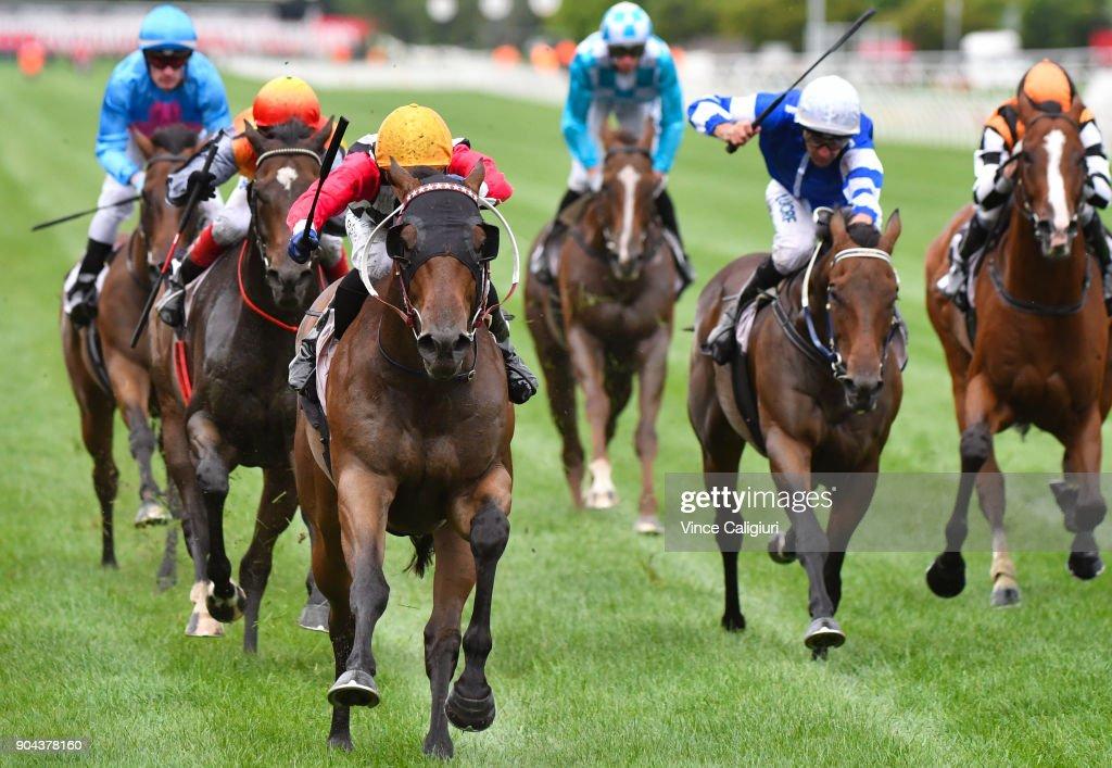Ben Allen riding Ken's Dream wins Race 8 at Flemington Racecourse on January 13, 2018 in Melbourne, Australia.