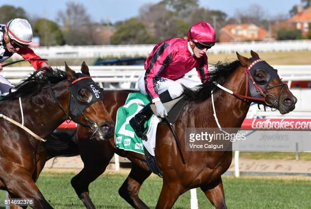 Ben Allen riding Nikitas defeats Brandon Stockdale riding Revolving Door in Race 6 during Melbourne Racing at Caulfield Racecourse on July 15 2017 in...