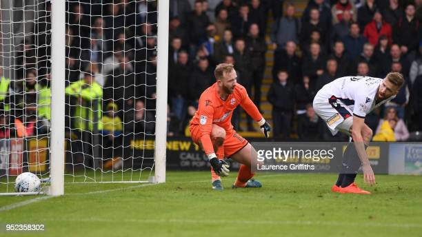 Ben Alnwick and Mark Beevers of Bolton Wanderers watch as the ball crosses the line as Lucas Akins of Burton Albion scores his side's second goal...