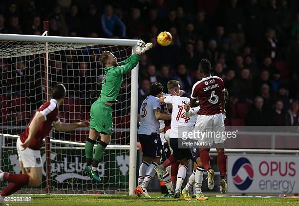 Ben Alnwick of Bolton Wanderers punches the ball clear during the Sky Bet League One match between Northampton Town and Bolton Wanderers at Sixfields...