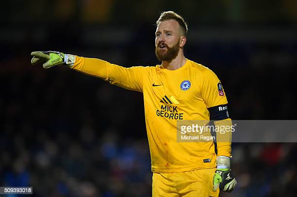 Ben Alnwick of Peterborough signals to his teammates during the Emirates FA Cup fourth round replay match between Peterborough United and West...