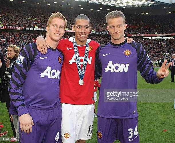 Ben Amos Chris Smalling and Anders Lindegaard of Manchester United celebrate after the Barclays Premier League match between Manchester United and...