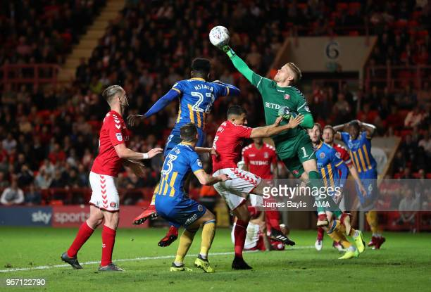 Ben Amos of Charlton Athletic punches the ball clear from Aristote Nsiala of Shrewsbury Town during the Sky Bet League One Play Off Semi FinalFirst...
