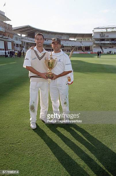 Ben and Adam Hollioake of Surrey with the Benson and Hedges Cup after Surrey win the Benson and Hedges Cup Final between Gloucestershire and Surrey...