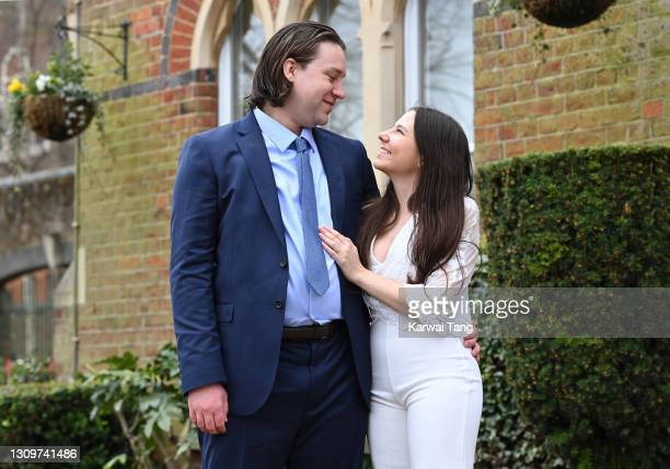 Ben and Gabriela Lloyd pose for photos as the first couple to get married at St Alban's Registry Office after the relaxation of the lockdown rule on...