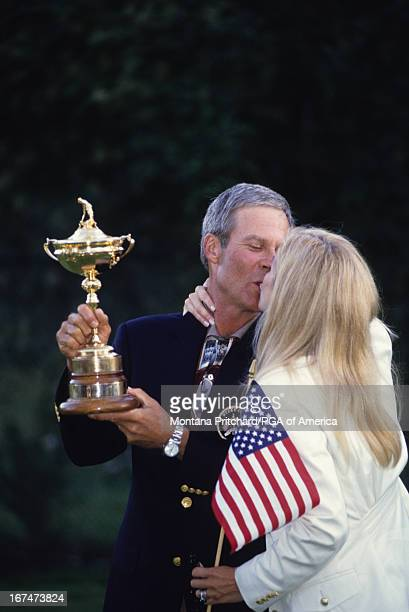 Ben and Julie Crenshaw with the Ryder Cup trophy at the 33rd Ryder Cup Matches held at The Country Club in Brookline Massachusetts Sunday September...