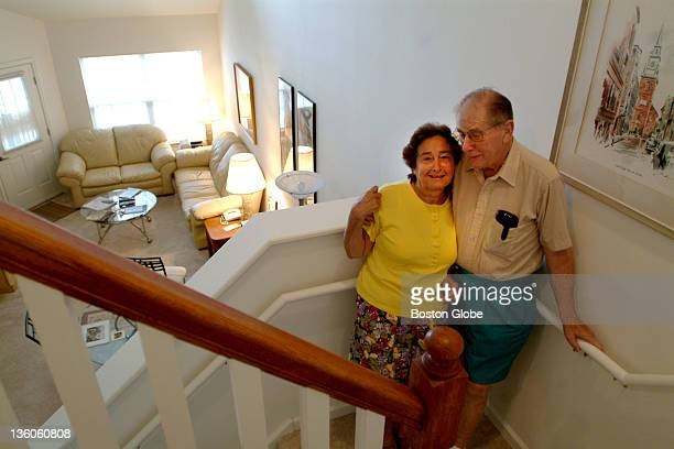 Ben and Phyllis Evans stand on the staircase inside of their rental apartment at the Avalon at Newton Highlands a luxury rental complex on Needham...