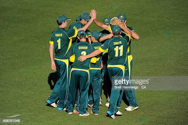 Ben Ashkenazi of Australia celebrates taking the wicket of Wayne Parnell of South Africa during the Men's International Tour Twenty20 match between...