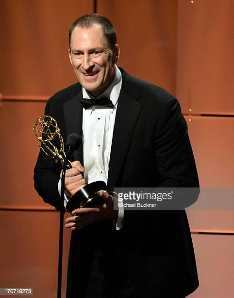 Ben Bailey accepts the Outstanding Game Show Host award for 'Cash Cab' onstage during the 40th Annual Daytime Emmy Awards at the Beverly Hilton Hotel...