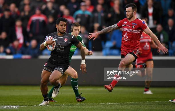 Ben Barba of St Helens gets past Jake Bibby of Salford during the Betfred Super League match between Salford Red Devils and St Helens at AJ Bell...