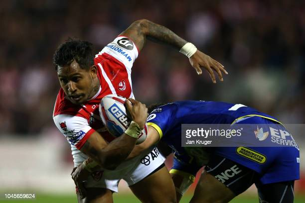 Ben Barba of St Helens is tackled by Tyrone Roberts of Warrington Wolves during the BetFred Super League semi final match between St Helens and...