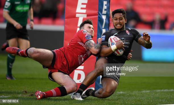Ben Barba of St Helens scores past Jake Bibby of Salford during the Betfred Super League match between Salford Red Devils and St Helens at AJ Bell...