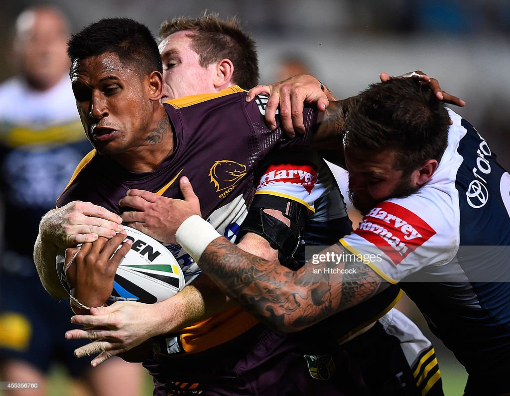 Ben Barba of the Broncos is tackled during the NRL 1st Elimination Final match between the North Queensland Cowboys and the Brisbane Broncos at 1300SMILES Stadium on September 13, 2014 in Townsville, Australia.