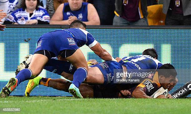 Ben Barba of the Broncos scores a try during the round 22 NRL match between the Brisbane Broncos and the Canterbury Bulldogs at Suncorp Stadium on...
