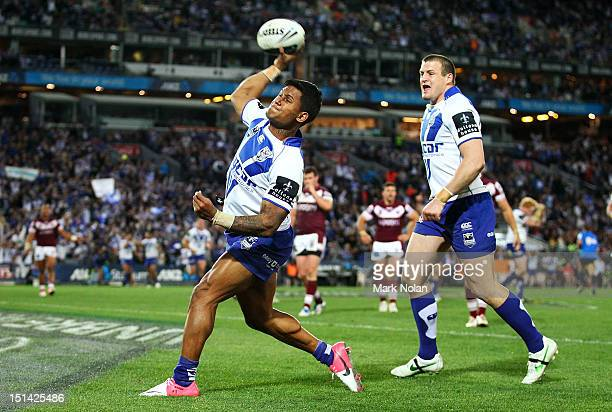 Ben Barba of the Bulldogs celebrates scoring a try that was later dis-allowed during the First NRL Qualifying Final match between the Canterbury...