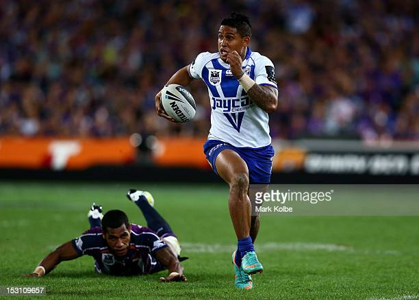 Ben Barba of the Bulldogs makes a break during the 2012 NRL Grand Final match between the Melbourne Storm and the Canterbury Bulldogs at ANZ Stadium...