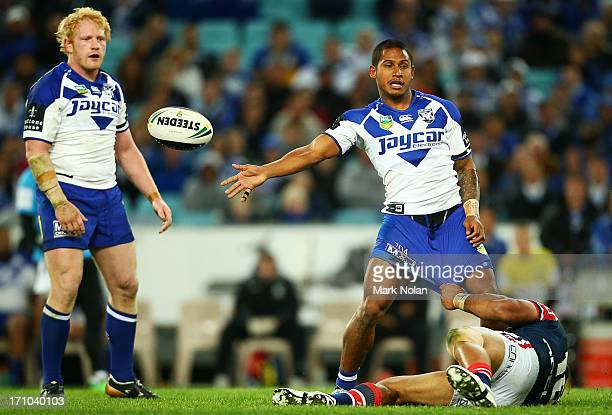 Ben Barba of the Bulldogs offloads during the round 15 NRL match between the Canterbury Bulldogs and the Sydney Roosters at ANZ Stadium on June 21...