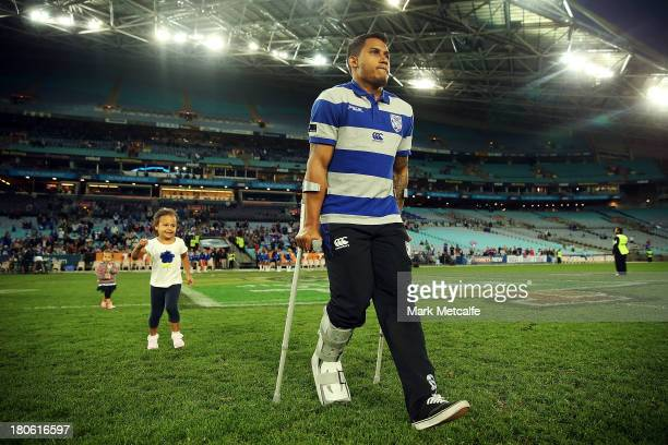 Ben Barba of the Bulldogs walks onto the field on crutches after being injured in the NRL Elimination Final match between the Canterbury Bulldogs and...