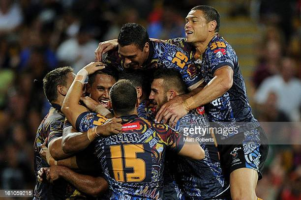 Ben Barba of the Indigenous All Stars celebrates a try with team mates during the NRL All Stars Game between the Indigenous All Stars and the NRL All...