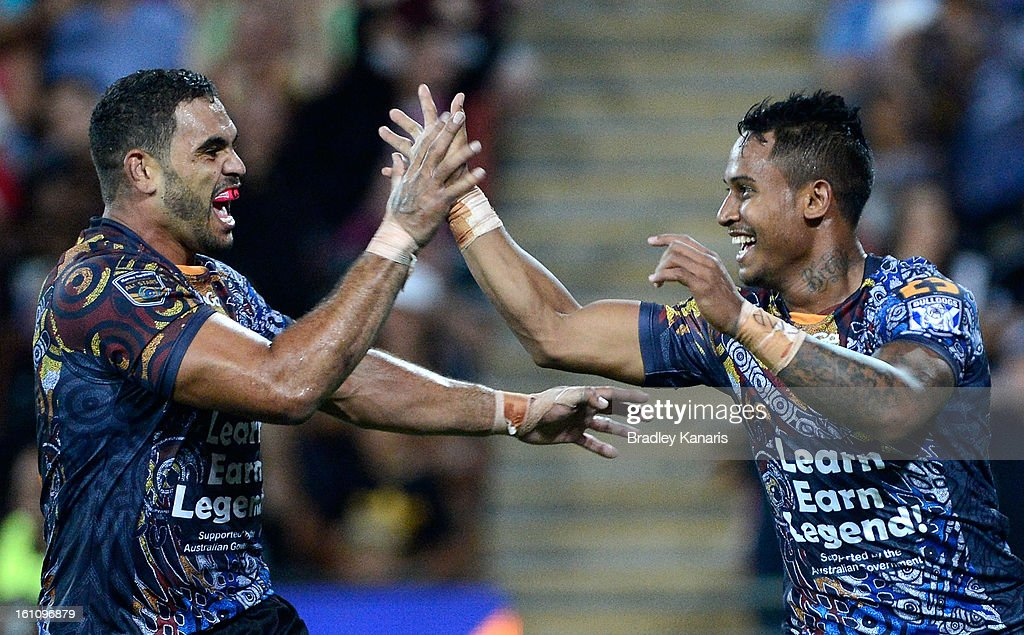 Ben Barba (R) of the Indigenous All Stars celebrates with team mate Greg Inglis after scoring a try during the NRL All Stars Game between the Indigenous All Stars and the NRL All Stars at Suncorp Stadium on February 9, 2013 in Brisbane, Australia.