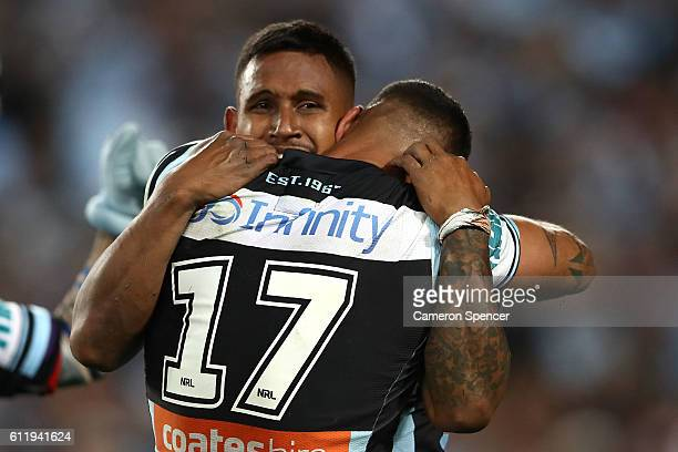 Ben Barba of the Sharks and Jason Bukuya of the Sharks celebrate winning the 2016 NRL Grand Final match between the Cronulla Sharks and the Melbourne...