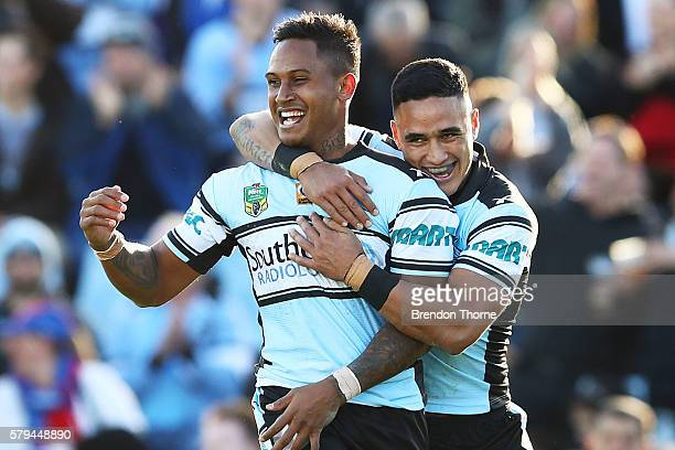 Ben Barba of the Sharks celebrates with team mate Valentine Holmes after scoring a try during the round 20 NRL match between the Cronulla Sharks and...