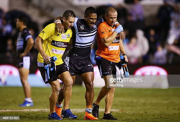 Ben Barba of the Sharks is assisted from the field injured during the round six NRL match between the Cronulla Sharks and the Newcastle Knights at...