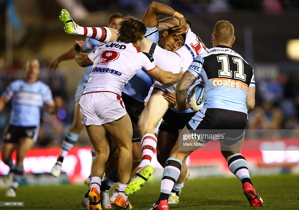 Ben Barba of the Sharks tackles Ben Creagh of the Dragons during the round 18 NRL match between the Cronulla Sharks and the St George Illawarra Dragons at Remondis Stadium on July 12, 2015 in Sydney, Australia.