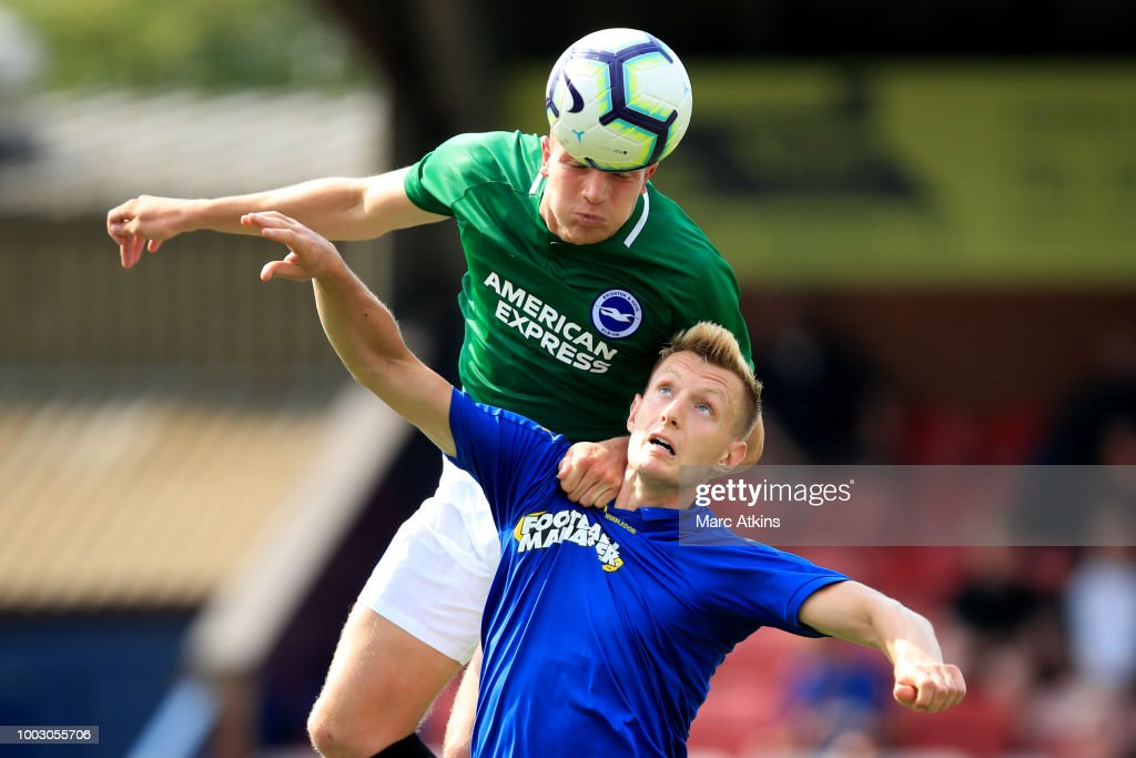 Ben Barclay of Brighton and Hove Albion in action with Joe Pigott of AFC Wimbledon during the pre season friendly match between AFC Wimbledon and Brighton and Hove Albion at The Cherry Red Records Stadium on July 21, 2018 in Kingston upon Thames, England.
