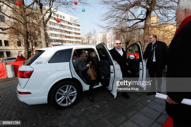 Ben Becker and his partner Anne Seidel arrive at the 'Der Gleiche Himmel' premier during the 67th Berlinale International Film Festival Berlin at...