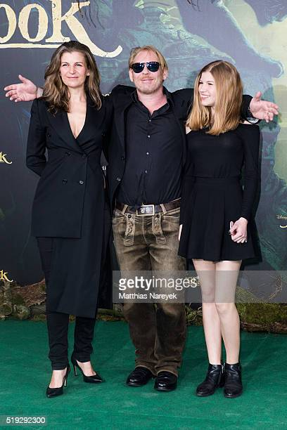 Ben Becker Anne Seidel and daughter Lllith attend the 'The Jungle book' German Premiere on April 5 2016 in Berlin Germany