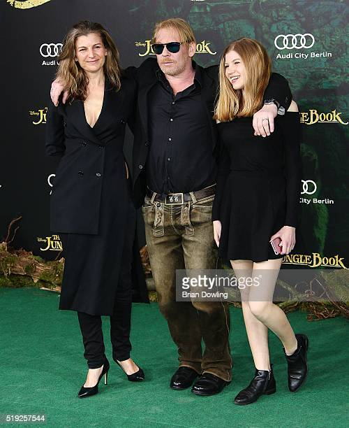 Ben Becker wife Anne Seidl and Doerthe Becker arrive at Disney's 'The Jungle Book' premiere at the Zoo Palast on April 5 2016 in Berlin Germany