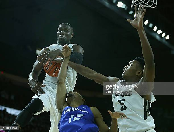 Ben Bentil and Rodney Bullock of the Providence Friars block the shot of Malik Albert of the Creighton Bluejays in the second half on March 2 at the...