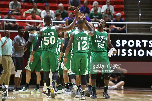 Ben Bentil of Boston Celtics Terry Rozier of Boston Celtics and Jayvaughn Pinkston of Boston Celtics shake hands during the game against the San...