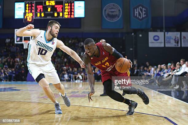 Ben Bentil of the Fort Wayne Mad Ants drives against Mike Tobey of the Greensboro Swarm during the game at the The Field House at the Greensboro...