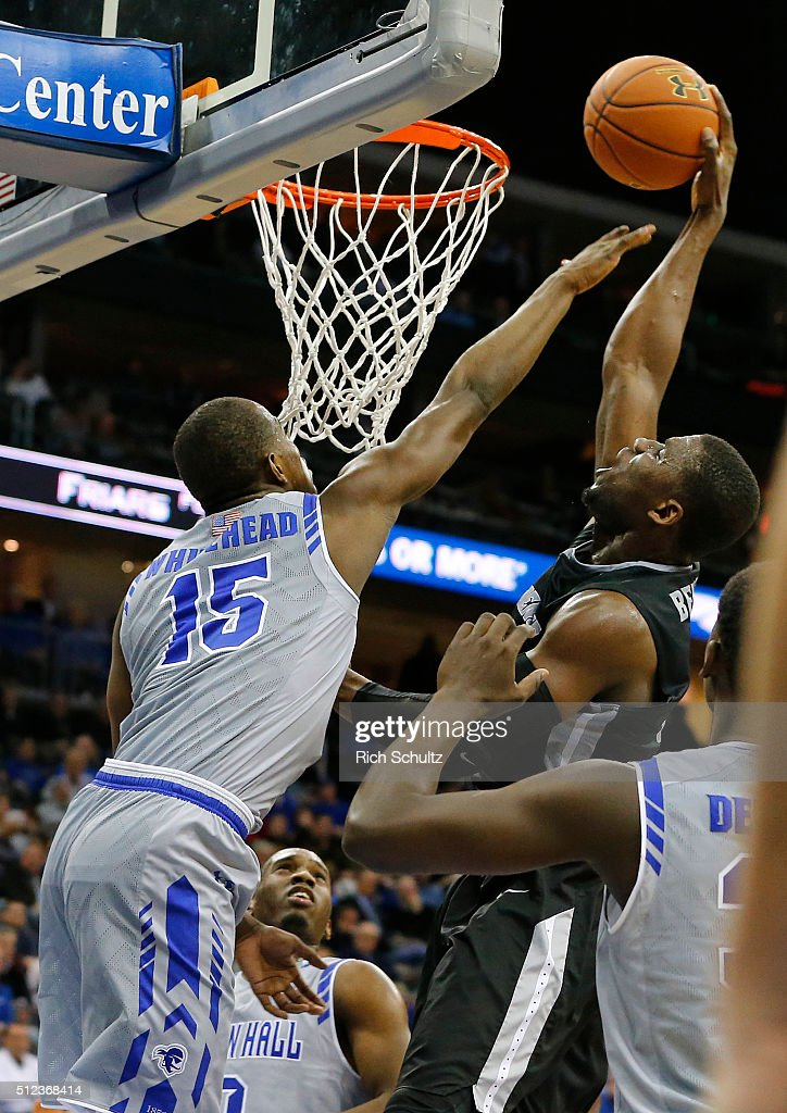 Ben Bentil #0 of the Providence Friars attempts a shot as Isaiah Whitehead #15 of the Seton Hall Pirates defends during the first half of an NCAA college basketball game on February 25, 2016 at the Prudential Center in Newark, New Jersey. Seton Hall defeated Providence 70-52.