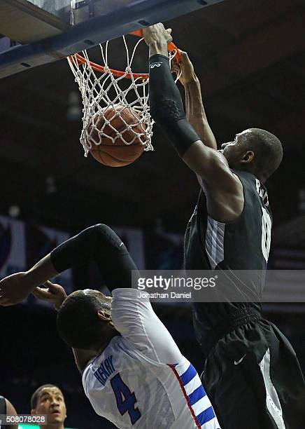 Ben Bentil of the Providence Friars dunks over Myke Henry of the DePaul Blue Demons at Allstate Arena on January 30 2016 in Rosemont Illinois