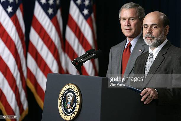 Ben Bernanke speaks as US President George W Bush looks on after a swearing in ceremony June 21 2005 at the Eisenhower Executive Office Building of...