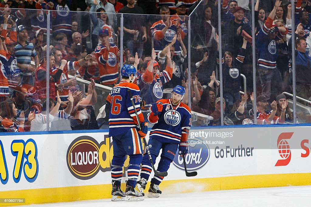 Ben Betker #76 and Kris Versteeg #13 of the Edmonton Oilers celebrate Versteeg's goal against the Calgary Flames in an NHL preseason game on September 26, 2016 at Rogers Place in Edmonton, Alberta, Canada.