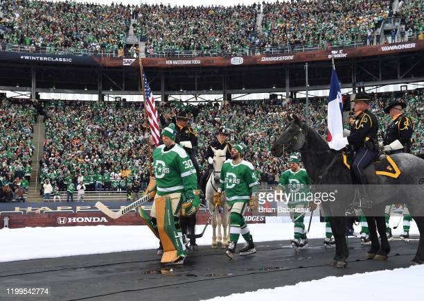 Ben Bishop Alexander Radulov Joe Pavelski and their Dallas Stars teammates walk to the ice for the 2020 NHL Winter Classic between the Nashville...