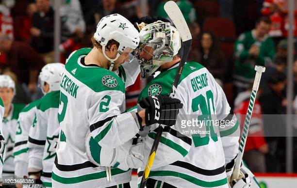 Ben Bishop and Jamie Oleksiak of the Dallas Stars celebrate after defeating the New Jersey Devils in overtime at Prudential Center on February 01...