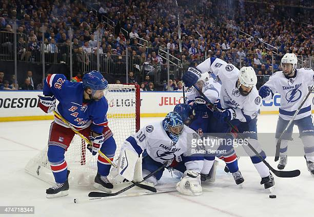 Ben Bishop and Jason Garrison of the Tampa Bay Lightning defend against Martin St Louis of the New York Rangers in Game Five of the Eastern...