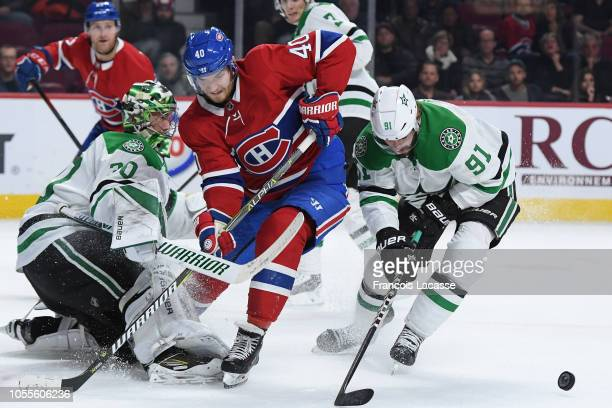 Ben Bishop and Tyler Seguin of the Dallas Stars defend the net against Joel Armia of the Montreal Canadiens in the NHL game at the Bell Centre on...