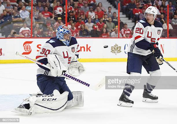 Ben Bishop of Team USA tracks the puck as Ryan Suter looks on during a World Cup of Hockey 2016 PreTournament game against Team Canada at Canadian...